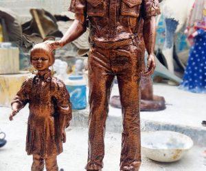navy sailor with schook kid fiberglass statue sculptures monuments karachi pakistan