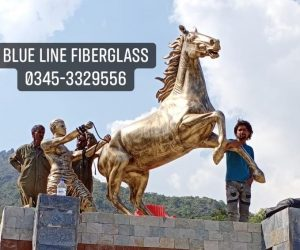 man pulling horse fiberglass statue sculptures monuments karachi pakistan