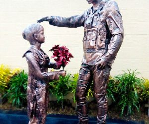 Girl Gives Flower to Soldier Statue Monument fiberglass sculptures karachi pakistan